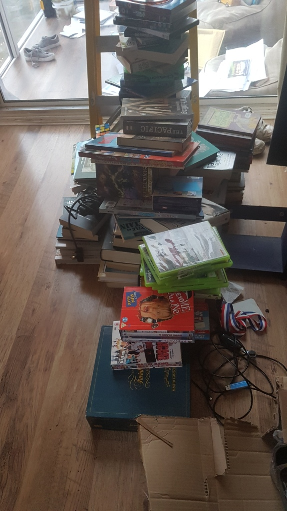 Pile of books and other bits and pieces ready for charity