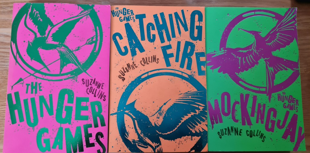 Book Covers of The Hunger Games; Catching Fire; Mockingjay  by Suzane Collins